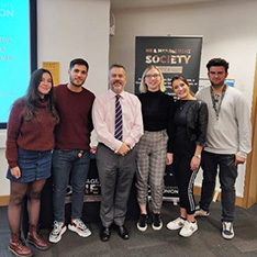 University students Emma and Alessia with COO James Rolfe and fellow students