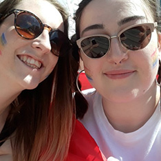 Sociology student Amy and friend at a Pride parade