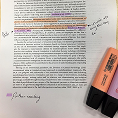 Academic paper with some sections highlighted in orange or pink