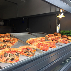 Pizza slices on display at Charlie's pizzeria in Cambridge