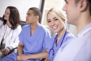 Group of doctors smiling and discussing