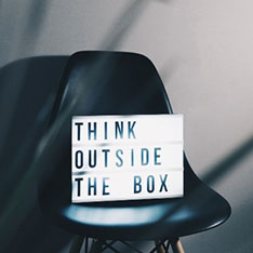 Light-up sign with the words Think Outside the Box