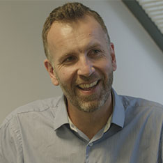 Image of Dr James Johnstone, Head of Department for Sports and Exercise Sciences in a grey shirt