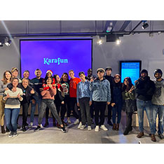 A group of students in front of a screen that reads 'Karafun'