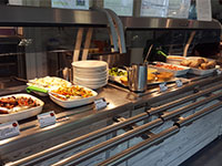 A picture of lasagne and other hot food in the Refectory