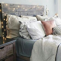 Picture of bed with lots of cushions
