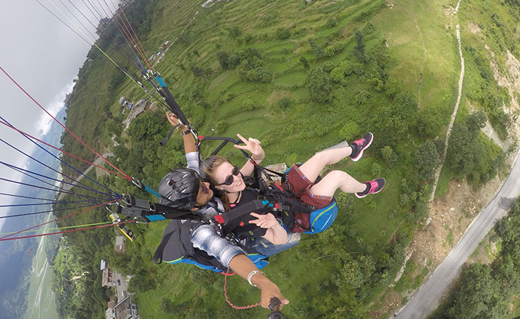 Anglia Ruskin student Jade paragliding in Nepal
