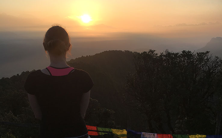 Anglia Ruskin student Jade watching a sunset in Nepal