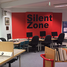 open desk area with a large silent study zone sign