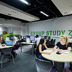 large open area with desks with group study zone sign on the wall