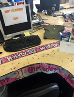 A desk decorated for a 21st birthday