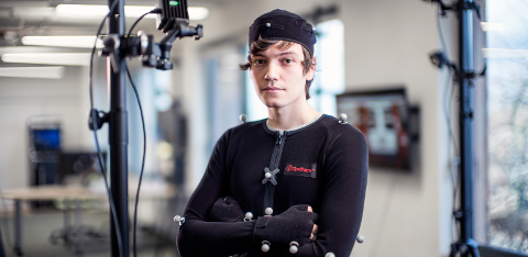 A computer games student wearing a motion capture suit