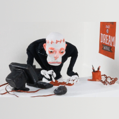 Claymation figure of a zombie using a pc