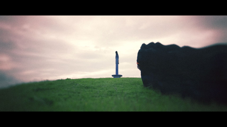 Photograph of humanoid statue in a field by Duncan Ganley