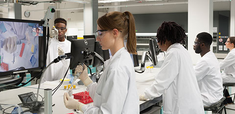 Students in Super Lab working in lab coats