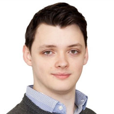 Headshot photo of Andrew Moore