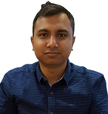 Headshot photo of Stiphen Chowdhury, wearing a blue shirt