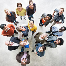 aerial view of diverse group of people looking up to camera