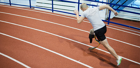 Paralympic athlete running on track