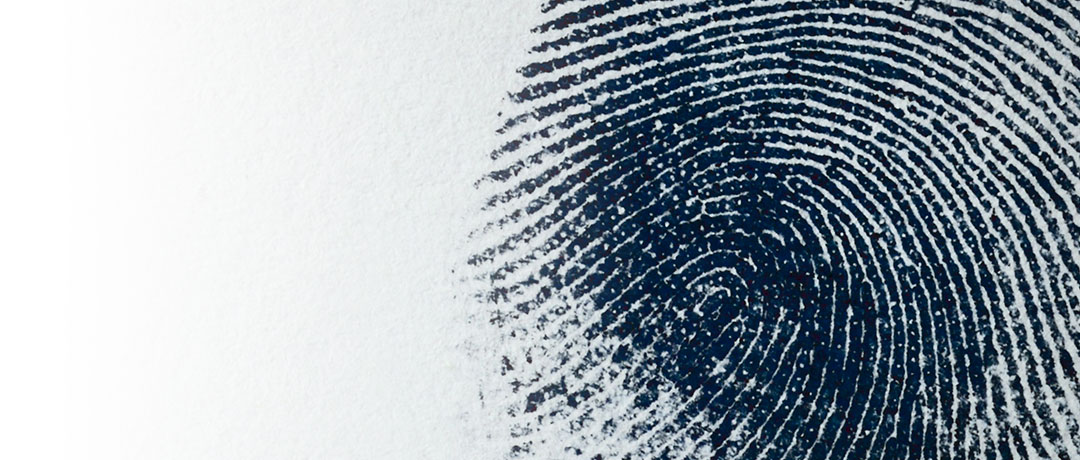 Close up of an inked fingerprint on paper