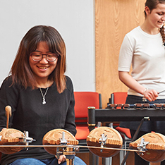 Female students playing percussion instruments