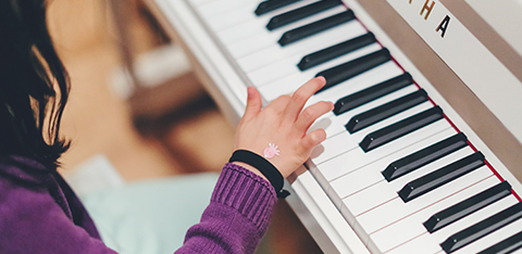 A hand playing the piano