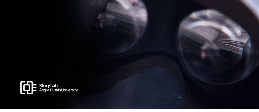 A book seen through the lenses of a pair of VR goggles; plus StoryLab logo
