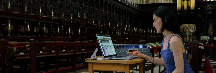 Mariana Lopez working on a laptop in a church