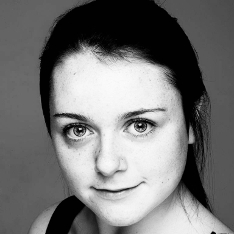 Laura Mackie head shot in black and white.