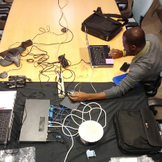 Marques Hardin working with music technology equipment