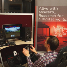 Guest at an event playing Dr Arne Nyaken's 'Safe and Sound Drive' game.