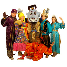 a group of actors, in traditional pantomime costume, smiling and waving