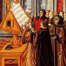 An image of a very old illustration (middle ages) of a group of men in robes stood around a lectern looking at a document