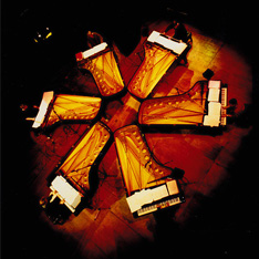 Aerial shot of 6 pianos in a circle with a pianist sat at each one