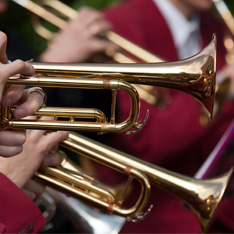 a closeup of a child playing the trumpet