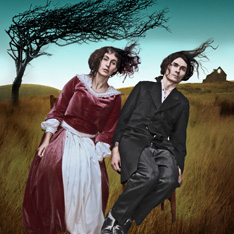 Two actors, dressed in period clothes sat on chairs in a field. They are bent over, as if being blown by the wind.