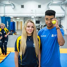 Anglia Ruskin Students in sport uniform standing in sport hall