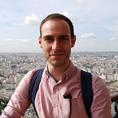 Dr Christopher Maidment, Lecturer in Town Planning, standing in front of a city landscape