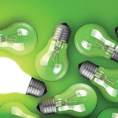 Lightbulbs in front of a green background