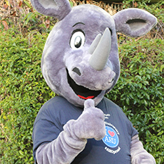 Ruskin the Rhino gives a thumbs up