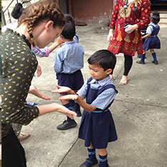 Volunteer teachers in Sainji playing with children from the village