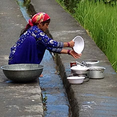 A woman in Sainji collecting water
