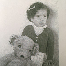 Babs Gibson-Ward as a child, with a teddy bear