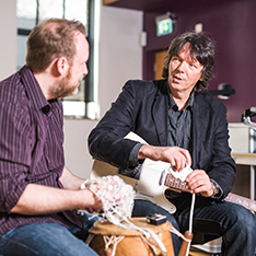 Dr Clemens Maidhof and Prof Jörg Fachner in a music therapy room