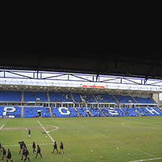 South Stand at Peterborough United FC with seats spelling out POSH