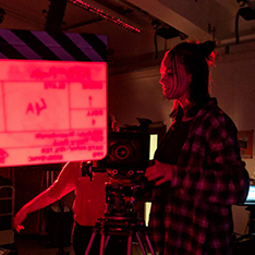 Film and Television Production student Gabi behind the camera in a studio