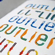Sketchbook containing the word 'outlier' repeated several times