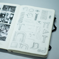 Sketchbook containing drawings of letters in different styles