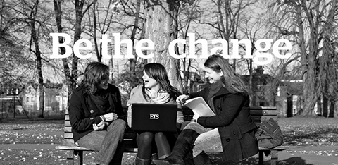 "Black and white girls with laptop with ""be the change"" slogan"