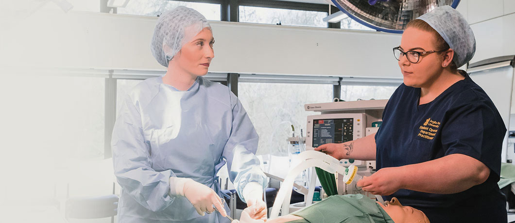Two women working in an operating theatre